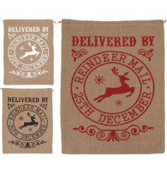 An assortment of 3 large jute material christmas sacks