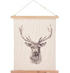 A beautiful assortment of hanging fabric canvases with a beautiful printed image of a stag on the centre