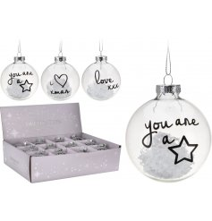 A quirky assortment of 4 clear plastic baubles with free flowing snow inside and a script quote on each