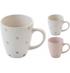 A mix of 2 chic ceramic mugs in cream and pink designs with gold polkadots.