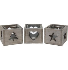 An assortment of 3 rustic wooden t-light holders, each with a tree, star or heart cut out design.