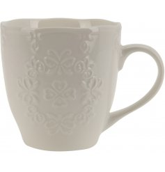 A beautiful vintage inspired mug with a scalloped edge and a pretty floral embossed design.