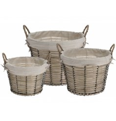 A set of 3 wicker baskets with cotton lining. A versatile and stylish storage item for the home.
