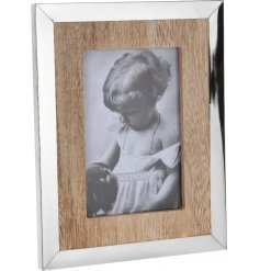 A distressed wooden base edged with a smooth metal frame builds up this new vintage chic range