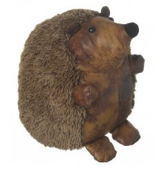 A happy hedgehog doorstop made from brown distressed look faux leather and faux fur.