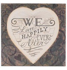"A romantic wall sign with elaborate calligraphy slogan ""and we lived happily ever after"""