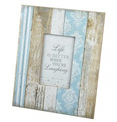 A shabby chic wood and wallpaper effect photo frame