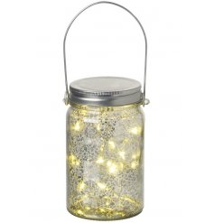 A mottled glass jar with handle and LED lights