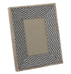 A tribal feel photo frame with black and white zig zag pattern