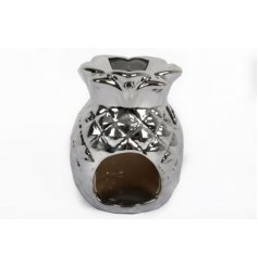A small silver pineapple oil burner