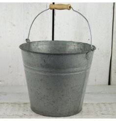 A medium sized traditional style double ridged zinc bucket greywashed