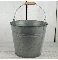 A medium sized traditional style double ridged zinc bucket greywashed