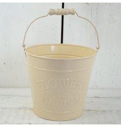 A medium cream zinc bucket with 'flowers & garden' embossed on side