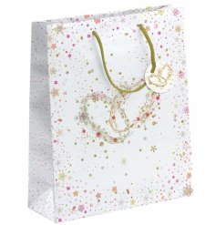 A large white wedding gift bag with twin rings design