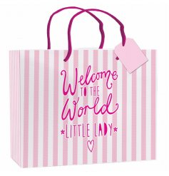 "An XL pink and white striped gift bag with ""welcome to the world little lady"" slogan on the side"