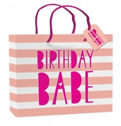 A stylish pink and white stripe gift bag with a Birthday Babe slogan with a gift tag.
