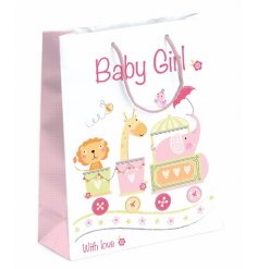 A pretty baby girl gift bag with an adorable circus design print.