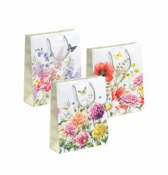 A beautiful assortment of floral themed gift bags, beautifully finished with bright elegant colours