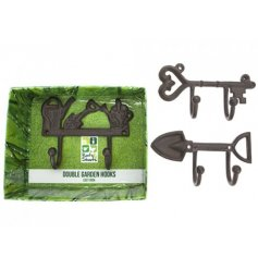 An assortment of 3 cast iron garden hooks