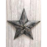 A black wooden Amish barn star