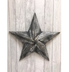 A black wooden Amish barn star