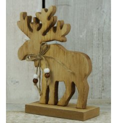 A large wooden moose standing decoration