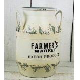 A small white farmers market zinc churn