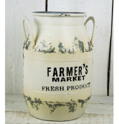 A small white farmers market zinc churn