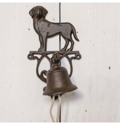 A decorative cast iron bell with an added dog decal