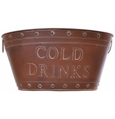 A rustic zinc copper coloured ice trough