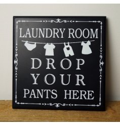 An amusing Drop your pants here laundry sign