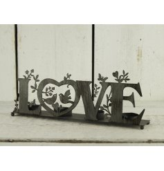 A beautifully rustic themed iron candle holder with an added LOVE text decal