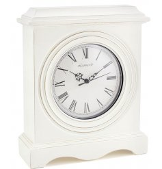 A stylish white wooden mantle clock, a perfectly simple statement piece for any neutral home