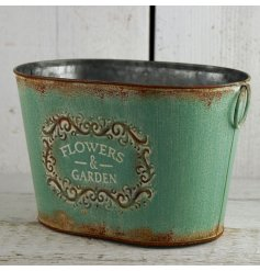 A beautifully distressed themed zinc planter, finished in a green vintage tone with a 'flowers and garden' script