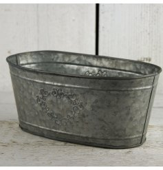 Add a chic touch to your garden display with this heart embossed zinc trough