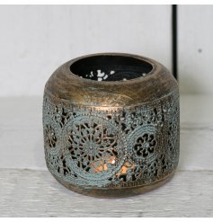 A beautifully aged inspired looking tlight holder, set in style with its rustic worn look and laser cut patterns