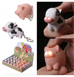 Bring the fun of the farm onto your keys with these funny little pig and cow torch keychains