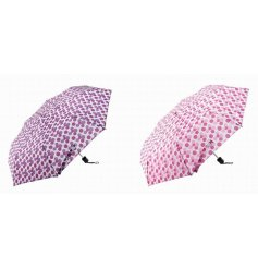 Dotty Folding Umbrella  Protect yourself in style with these quirky pink spotted folding umbrellas