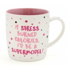 A glam pink themed mug with a comical script quote on the front