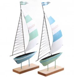 Bring a touch of the coast to your home with this nautical inspired assortment of metal boats