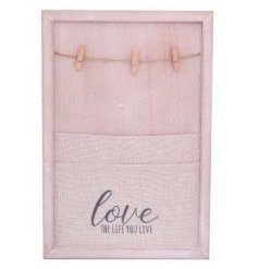 A Canvas & Peg Memo Board with Love The Life You Live quote