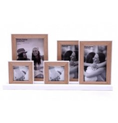 A shabby chic inspired set of standing wooden frames on a white base