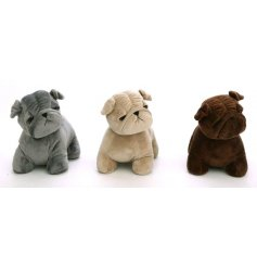 An assortment of 3 pug doorstops