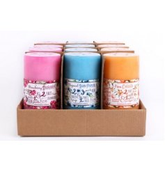 A mix of 3 cocktail scented pillar candles set in a tropical inspired design