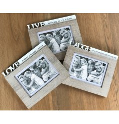 An assortment of 3 wooden frames with the popular 'live, laugh and love' quotes