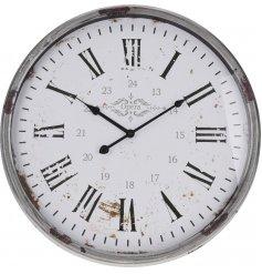 A rustic metal clock