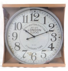 A chic and distressed wall clock with a popular 'Kensington Station' printed face