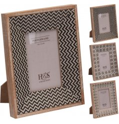 An assortment of 3 natural toned patterned photo frames