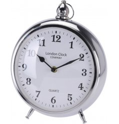 A round silver table clock
