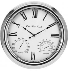 A silver metal clock for outside